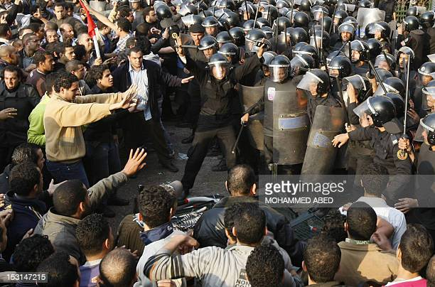 Egyptian demonstrators clash with Egyptian police in central Cairo during a protest to demand the ouster of President Hosni Mubarak and calling for...