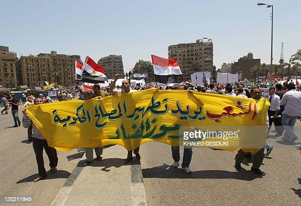 Egyptian demonstrators hold a banner that reads in Arabic 'the people want clean governmental institutions from corruption' during a rally in...