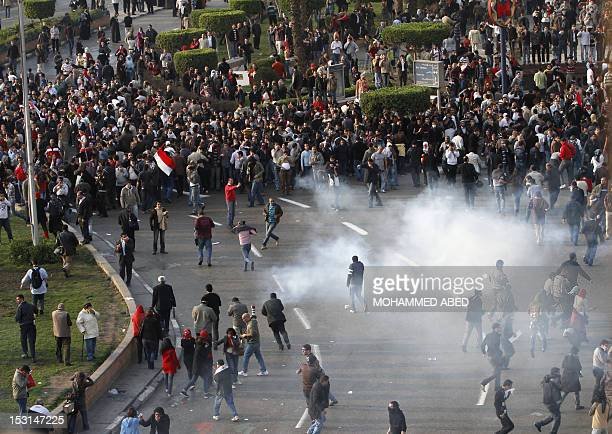 Egyptian demonstrators protest in central Cairo amidst tear gas fire by Egyptian police to demand the ouster of President Hosni Mubarak and calling...