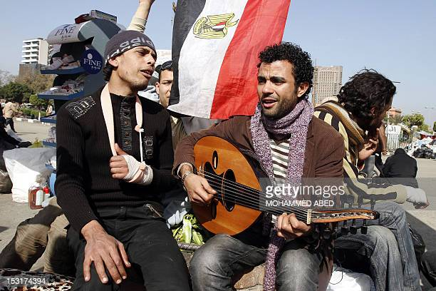 Egyptian demonstrators sing antiMubarak songs at Cairo's Tahrir square on February 6 2011 on the 13th day of protests calling for the ouster of...