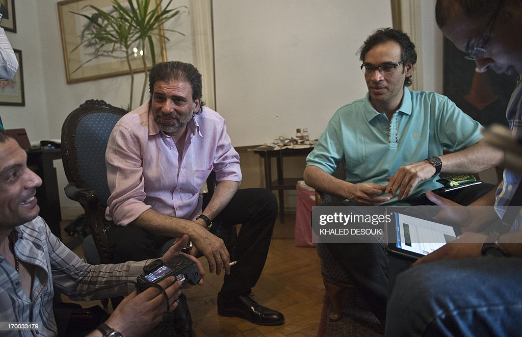 Egyptian director Khaled Yuossef (2-L) attends a meeting with Egyptian intellectuals as they undertake a sit-in at the office of culture minister Alaa Abdelfattah in Cairo on June 6, 2013, calling for his resignation.