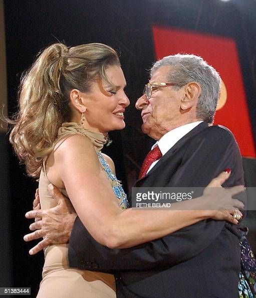 Egyptian director Youssef Shahine kisses Egyptian actress Yousra at the opening of the Carthage film festival 01 October 2004 in Tunis AFP PHOTO/...