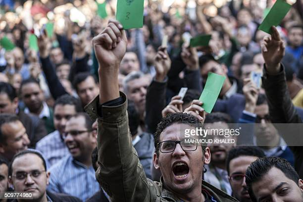 Egyptian doctors gather outside their syndicate in Cairo on February 12 to protest against an assault by policemen on two of their colleagues in a...
