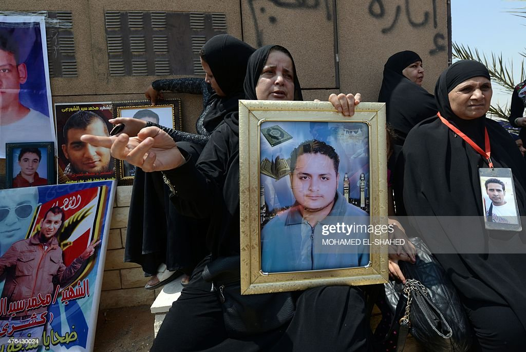 Egyptian families of the victims of a February 2012 riot in the eastern city of Port Said gather outside a court in Cairo on June 9 2015 as they wait...