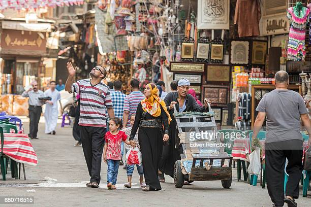 Egyptian family walks through open air market