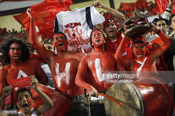 Egyptian fans cheer before the start of the African Champions League second leg final football match between AlAhly of Egypt and Etoile du Sahel of...