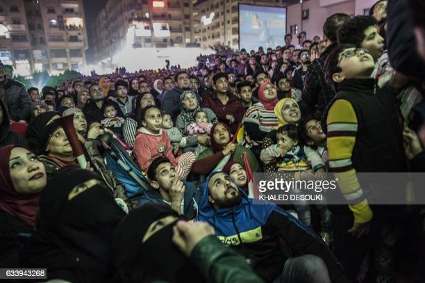 Egyptian fans react as they watch on a screen the Africa Cup of Nations football match between Egypt and Cameroon on February 5 in the capital Cairo...