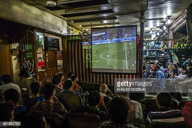 Egyptian fans watch the FIFA World Cup semifinal football match between Netherlands and Argentina late on July 9 at a cafe in the capital Cairo AFP...