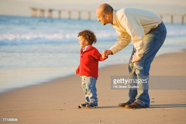 Egyptian father and son on beach