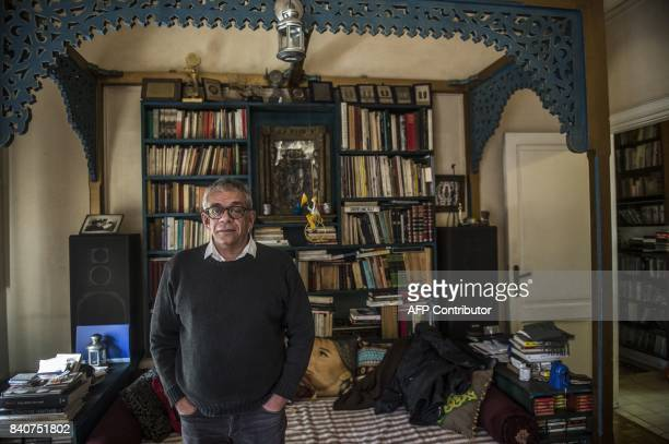 Egyptian film director Yousry Nasrallah is pictured during an interview with AFP at his home in the capital Cairo on February 12 2017 / AFP PHOTO /...