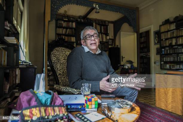 Egyptian film director Yousry Nasrallah talks during an interview with AFP at his home in the capital Cairo on February 12 2017 / AFP PHOTO / KHALED...