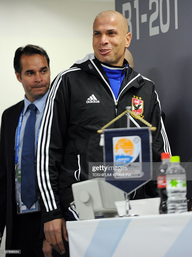 Egyptian football club team Al Ahly defender Wael Gomaa (R) arrives for a press conference prior to an official team training session for the 2012 Club World Cup in Japan tournament at Toyota Stadium in Toyota, Aichi prefecture on December 8, 2012. The African champions will make an emotional return to the international stage on December 9 when they play Sanfrecce Hiroshima for a place in the semi-finals of the showpiece event in Japan. AFP PHOTO / TOSHIFUMI KITAMURA