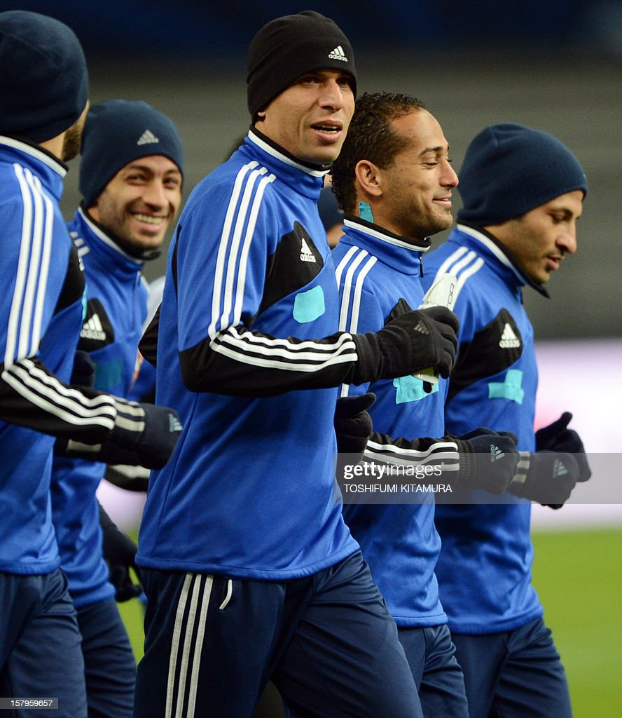 Egyptian football club team Al Ahly defender Wael Gomaa (C) jogs with his teammates during an official team training session for the 2012 Club World Cup in Japan tournament at Toyota Stadium in Toyota, Aichi prefecture on December 8, 2012. The African champions will make an emotional return to the international stage on December 9 when they play Sanfrecce Hiroshima for a place in the semi-finals of the showpiece event in Japan. AFP PHOTO / TOSHIFUMI KITAMURA