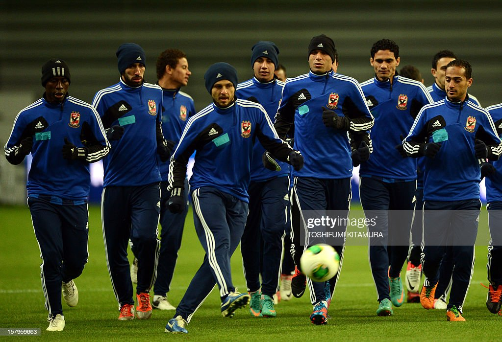 Egyptian football club team Al Ahly defender Wael Gomaa (4th R) leads teammates during an official team training session for the 2012 Club World Cup in Japan tournament at Toyota Stadium in Toyota, Aichi prefecture on December 8, 2012. The African champions will make an emotional return to the international stage on December 9 when they play Sanfrecce Hiroshima for a place in the semi-finals of the showpiece event in Japan.