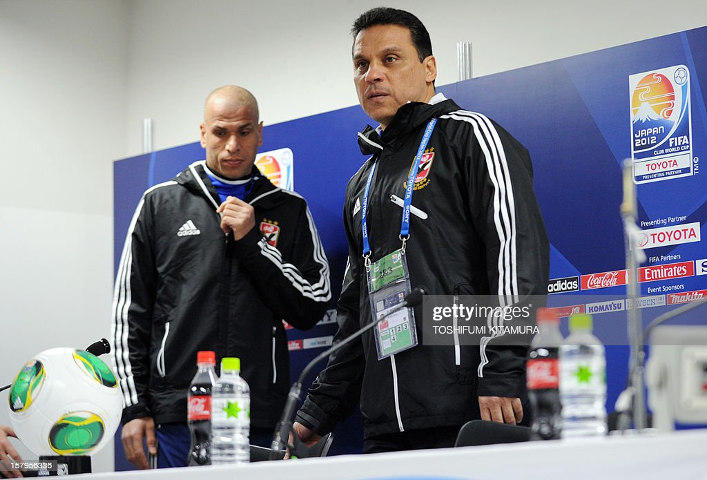 Egyptian football club team Al Ahly head coach Hossam El-Badry (R) and defender Wael Gomaa (L) enter for a press conference prior to an official team training session for the 2012 Club World Cup in Japan tournament at Toyota Stadium in Toyota, Aichi prefecture on December 8, 2012. The African champions will make an emotional return to the international stage on December 9 when they play Sanfrecce Hiroshima for a place in the semi-finals of the showpiece event in Japan. AFP PHOTO / TOSHIFUMI KITAMURA