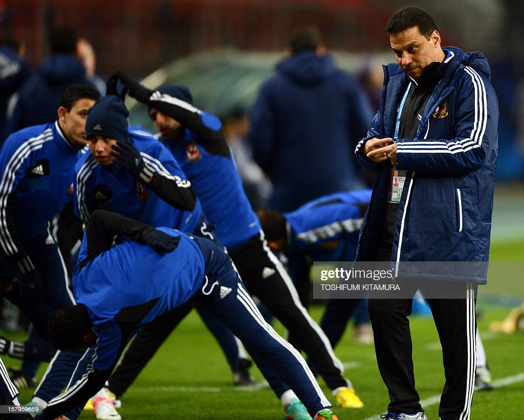Egyptian football club team Al Ahly head coach Hossam El-Badry (R) watches his players work out during an official team training session for the 2012 Club World Cup in Japan tournament at Toyota Stadium in Toyota, Aichi prefecture on December 8, 2012. The African champions will make an emotional return to the international stage on December 9 when they play Sanfrecce Hiroshima for a place in the semi-finals of the showpiece event in Japan. AFP PHOTO / TOSHIFUMI KITAMURA