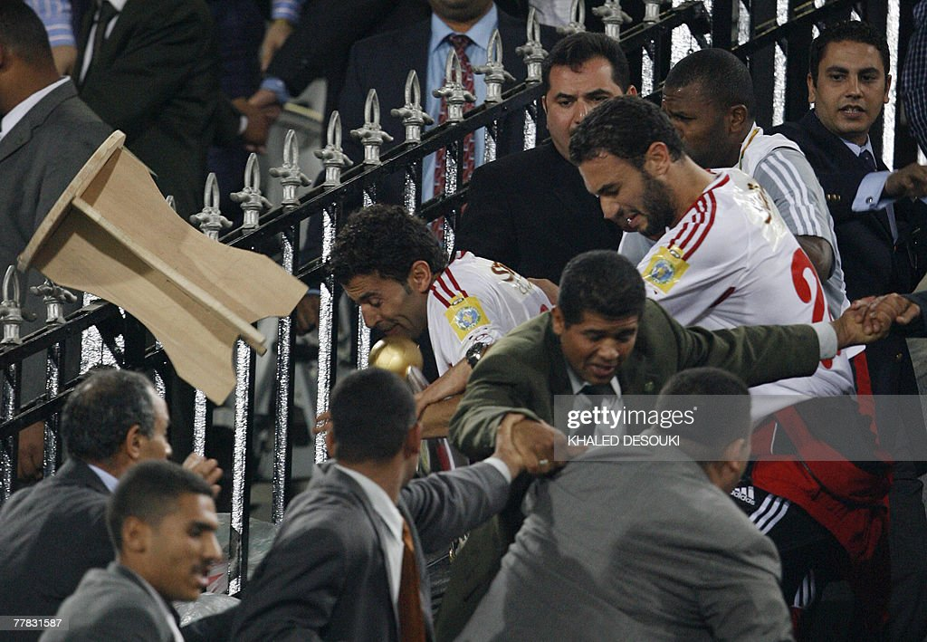 Egyptian football fans throw objects at Tunisia's Etoile Sahel players after the Tunisian team won the African Champions League second leg final...