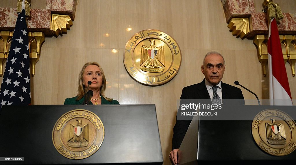 Egyptian Foreign Minister Mohammed Kamel Amr (R) and US Secretary of state Hillary Clinton give a joint press conference after their meeting with President Mohamed Morsi in the presidential palace in Cairo on November 21, 2012. Amr announced that a truce had been agreed between Israel and Hamas to end a week of bloodshed in and around Gaza and said a ceasefire would take effect at 1900 GMT.