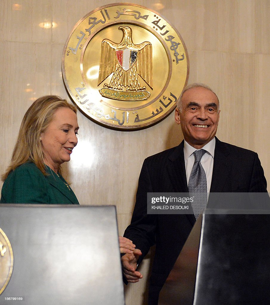 Egyptian Foreign Minister Mohammed Kamel Amr (R) and US Secretary of state Hillary Clinton get ready to leave following their joint press conference in Cairo on November 21, 2012. Amr announced that a truce had been agreed between Israel and Hamas to end a week of bloodshed in and around Gaza and said a ceasefire would take effect at 1900 GMT.
