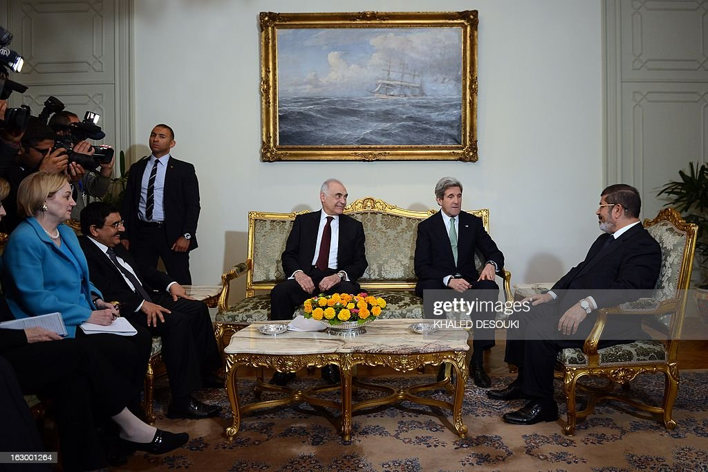 Egyptian Foreign Minister Mohammed Kamel Amr (3rdR) and US Secretary of State John Kerry (2ndR) meets with Egyptian President Mohamed Morsi (R) at the presidential palace in Cairo on March 3, 2013. Kerry met the Egyptian president as he wrapped up a trip to Cairo, where he urged divided factions to reach a consensus that would pave the way for economic recovery.