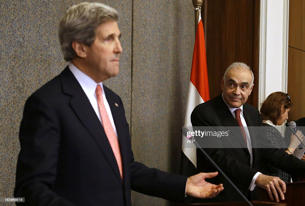Egyptian Foreign Minister Mohammed Kamel Amr (R) holds a joint press conference with US Secretary of State John Kerry at the foreign ministry in Cairo on March 2, 2013. Kerry is in Cairo to push for a way out of Egypt's violence-wracked political impasse, underlining the need for a consensus to overcome a crippling economic crisis.