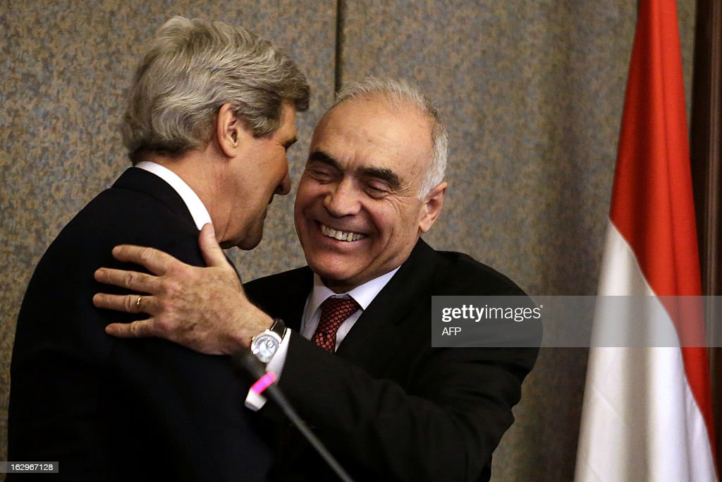 Egyptian Foreign Minister Mohammed Kamel Amr (R) hugs US Secretary of State John Kerry after they spoke to the media at the foreign ministry in Cairo on March 2, 2013. Kerry is in Cairo to push for a way out of Egypt's violence-wracked political impasse, underlining the need for a consensus to overcome a crippling economic crisis.