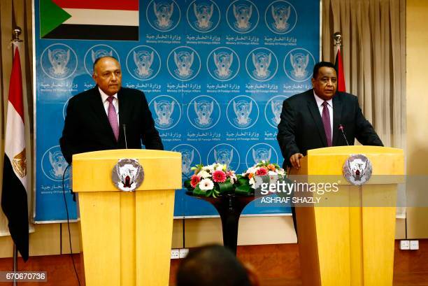 Egyptian Foreign Minister Sameh Shokry and his Sudanese counterpart Ibrahim Ghandour give a press conference in Khartoum on April 20 2017 Relations...