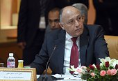 Egyptian Foreign Minister Sameh Shoukry listens during the 8th ministerial meeting of Libya's neighbouring countries on March 22 2016 in Tunis...