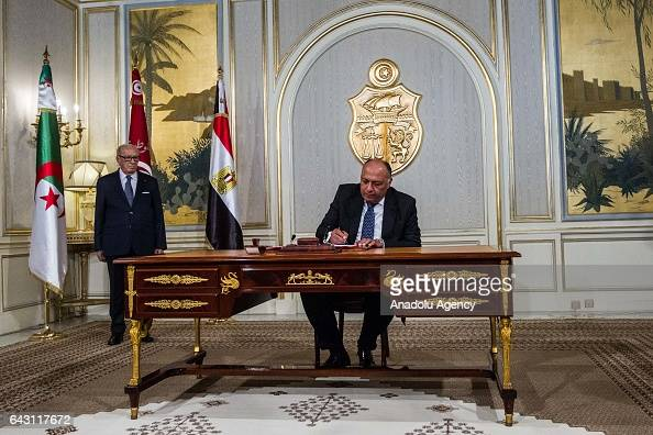 Egyptian Foreign Minister Sameh Shoukry signs a memorandum of understanding as he gathers with Tunisian President Beji Caid Essebsi Tunisian Foreign...