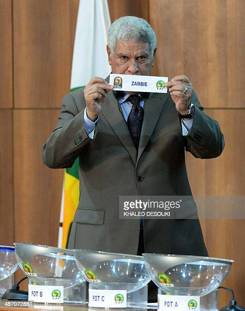 Egyptian former national team head coach Hasan Shehata holds the lot of Zambia during the draw for the preliminary and group phases of the 2015...