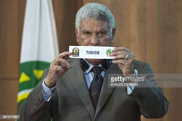 Egyptian former national team head coach Hasan Shehata holds the lot of Tunisia during the draw for the preliminary and group phases of the 2015...