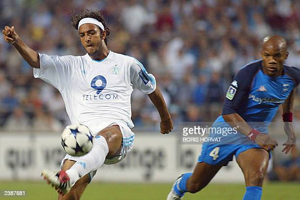 Egyptian forward Ahmed Hossam Mido from Marseille kicks the ball as Auxerre's defender JeanAlain Boumsong looks on during their French L1 soccer...