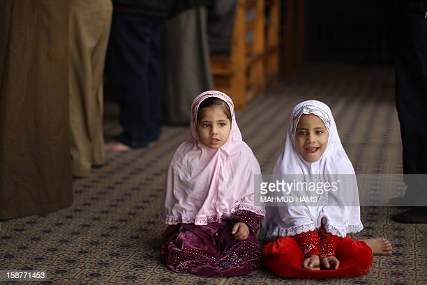 Egyptian girls sit in AlAzhar mosque in Cairo during the weekly Friday prayer on December 28 prior to a gathering in support of the Syrian people...