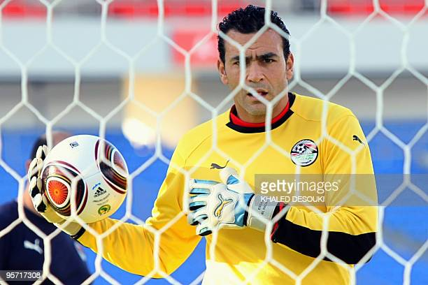 Egyptian goalkeeper Esam elHadary footballer warms up as he takes part in a training session at Ombaka stadium in Benguela on January 11 2010 on the...