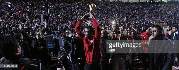Egyptian goalkeeper Essam alHadary parades the trophy of the African Cup of Nations during a benefit concert in Cairo for the victims of recent...