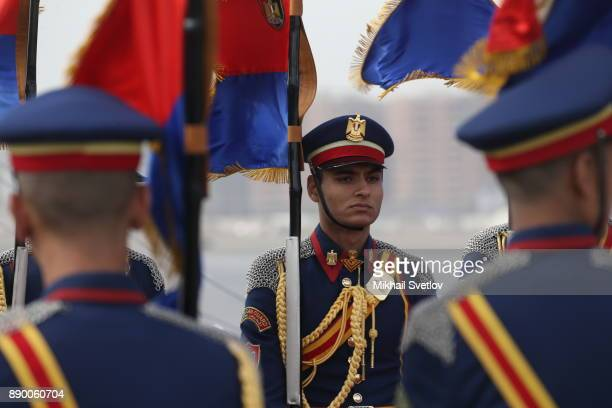 Egyptian honour guards await for Russian President Vladimir Putin's arrival proir the welcoming ceremony at the airport on December 11 2017 in Cairo...