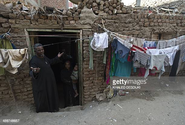 Egyptian horse cart owner Salah stands at the entrance to his family house in the southern city of Luxor on December 21 2013 The 2011 revolution that...
