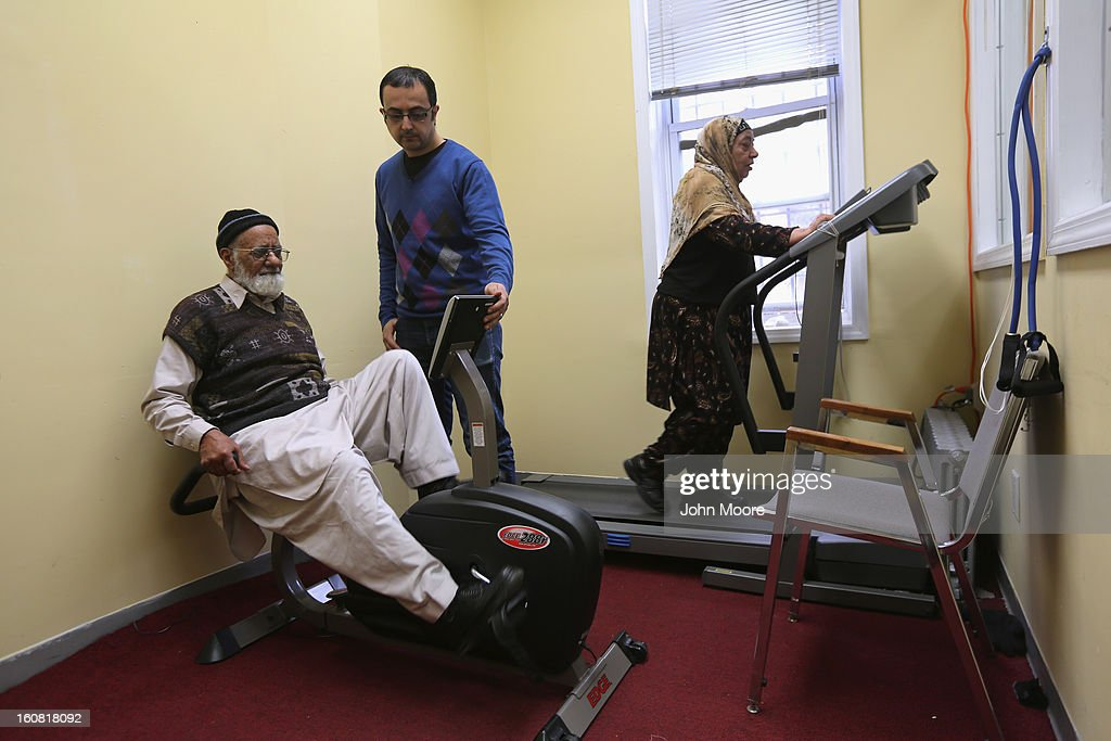 Egyptian immigrant Wael Masri, assists Pakistani immigrant Wahid Ali, 78, a naturalized American from Pakistan, in the exercise room of the Council of Peoples Organization (COPO), after an English and U.S. citizenship class held there on February 6, 2013 in New York City. The non-profit COPO, founded in early 2002 shortly after the 9/11 attacks, is designed to help immigrants, mostly from Pakistan, to assimilate to American culture and, in many cases, gain U.S. citizenship.