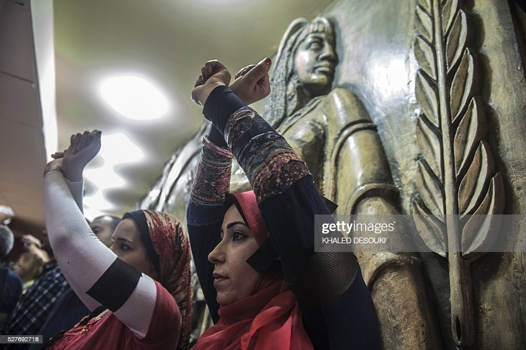 Egyptian journalist cross their hands symbolising being handcuffed during a protest inside the Syndicate headquarters in Cairo on May 3, 2016 on the occasion of World Press Freedom day, a day after police stormed the headquarters of the journalists' association and arrested two journalists. Egyptian authorities on May 2 ordered the detention of two journalists for 15 days after their arrest on allegations of incitement to protest, a judicial source said. The decision comes a day after police stormed the headquarters of the journalists' association in central Cairo and arrested Amr Badr and Mahmud el-Sakka. A judicial source on Sunday said the pair had been wanted for alleged incitement to protest in violation of the law. / AFP / KHALED