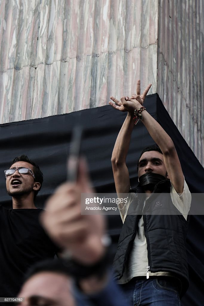 Egyptian journalists gathered in front of the Journalists Union stage a demonstration to protest the detention of two journalists by the Egyptian security forces in Cairo, Egypt on May 3, 2016.