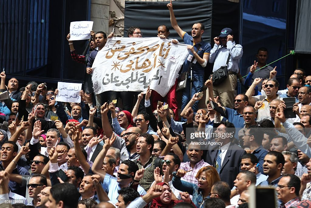 Egyptian journalists shout slogans during protest after security forces raided the Syndicate down town Cairo, Egypt, 04 May 2016. Hundreds of Egyptian Journalists gathered for an urgent assembly meeting in the Syndicate of Journalists building to discuss measures of escalation.
