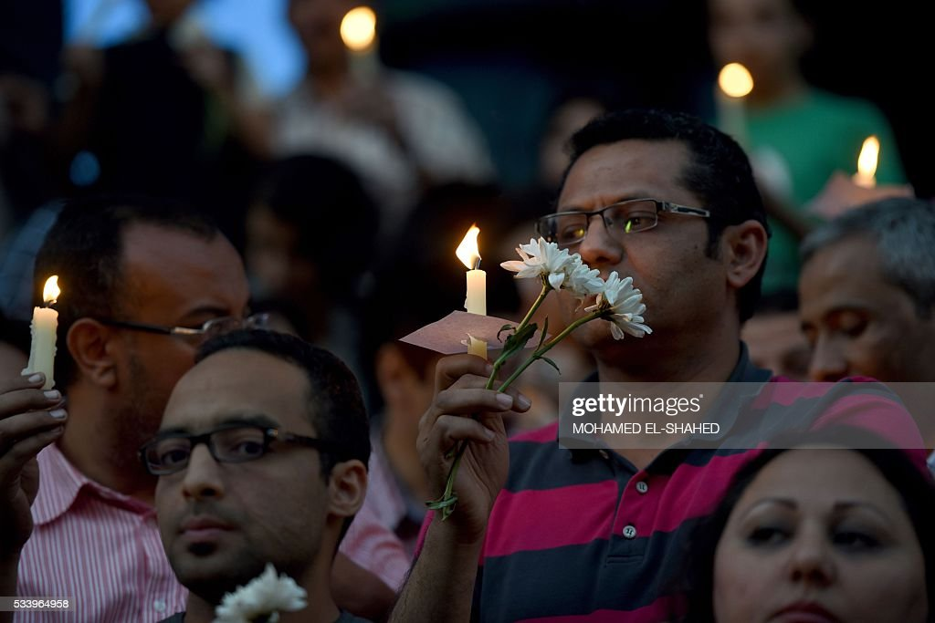 Egyptian journalist take part in a candle light vigil in memory of EgyptAir MS804 victims in front of the Journalists' Syndicate in Cairo on May 24, 2016. The Airbus A320 carrying 66 people had crashed into the sea while flying from Paris to Cairo early May 19, 2016, and some wreckage but not the black boxes has been found. SHAHED