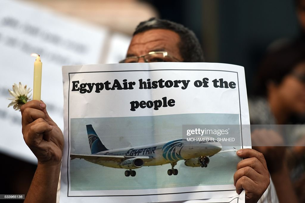 Egyptian journalists take part in a candle light vigil in memory of EgyptAir MS804 victims in front of the Journalists' Syndicate in Cairo on May 24, 2016. The Airbus A320 carrying 66 people crashed into the sea while flying from Paris to Cairo early May 19, 2016, and some wreckage but not the black boxes has been found. SHAHED