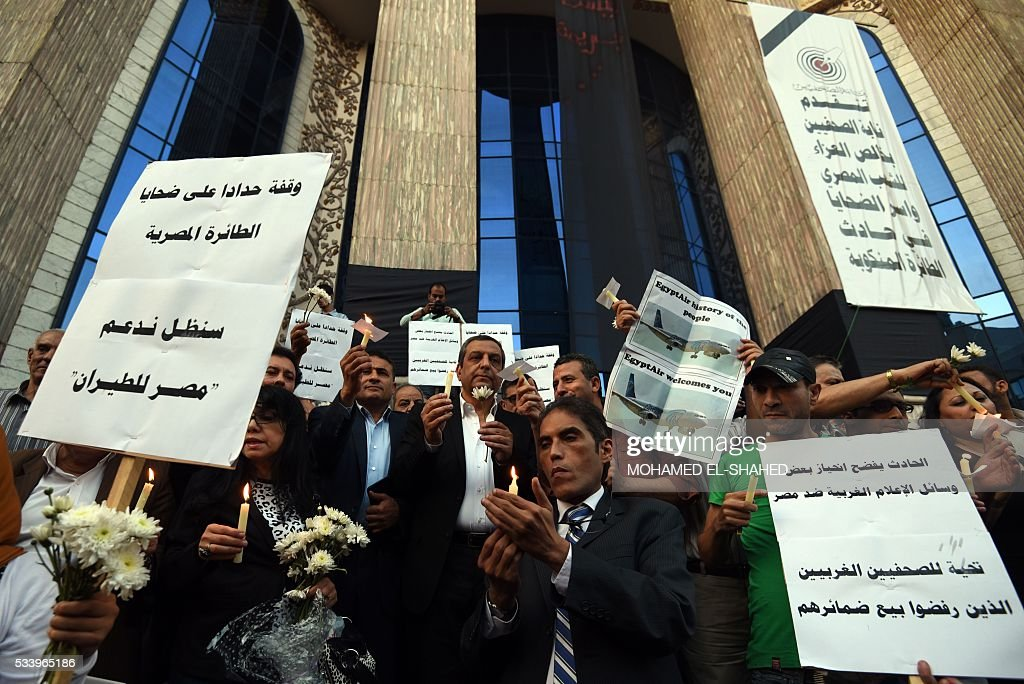 Egyptian journalists take part in a candle light vigil in memory of EgyptAir MS804 victims in front of the Journalists' Syndicate in Cairo on May 24, 2016. The Airbus A320 carrying 66 people had crashed into the sea while flying from Paris to Cairo early May 19, 2016, and some wreckage but not the black boxes has been found. SHAHED