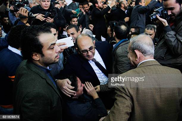 Egyptian lawyer and leftist opposition figure Khaled Ali stands among people outside the State Council's building Egypt's highest administrative...