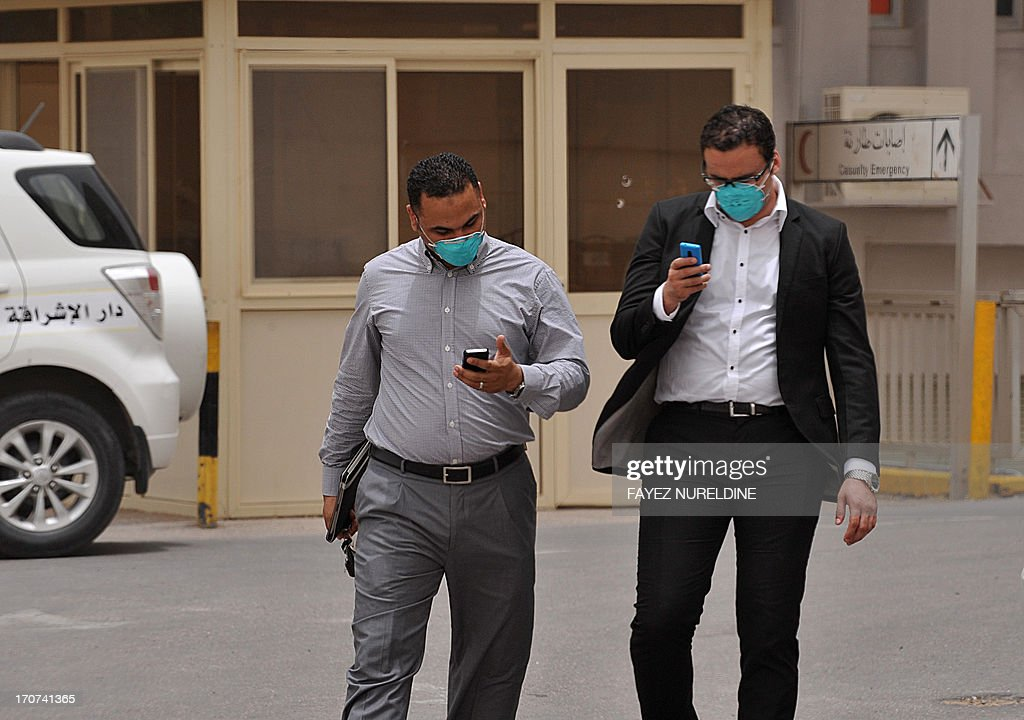 Egyptian medical workers wear masks as they leave the emergency section in King Fahad hospital in the city of Hofuf, 370 kms East of the Saudi capital Riyadh, on June 16, 2013. Four people have died from the MERS virus in Saudi Arabia, bringing the death toll from the SARS-like virus in the kingdom to 32, the health ministry said. The World Health Organisation announced that the global death toll from MERS had reached 33, with 28 of them in the kingdom. The virus is a member of the coronavirus family, which includes the pathogen that causes Severe Acute Respiratory Syndrome (SARS).