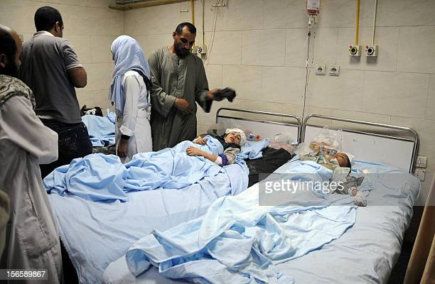 Egyptian medics and family members attend to wounded children at a hospital in Assiut on November 17 who were injured when a train smashed into a...
