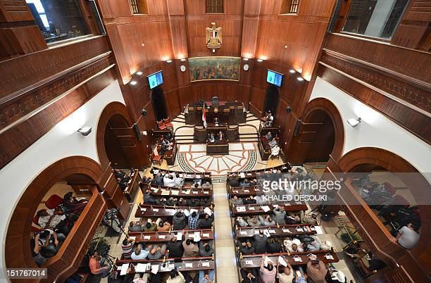 Egyptian members of the constitution committee listen to USEgyptian Nobel prizewinning scientist Ahmed Zewail at the Shura council in Cairo on...