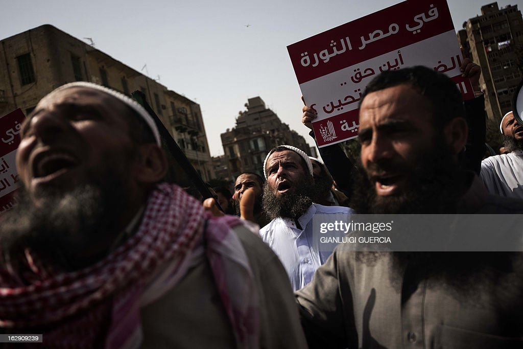Egyptian men shout religious and political slogans as hundreds of Salafists demonstrate over a lack of enforcement of a recent court order permitting bearded police officers to serve in Cairo on March 1, 2013.
