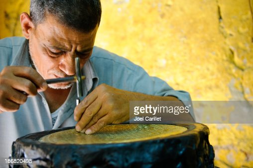Egyptian metal worker doing his craft